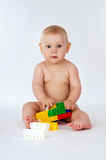 Happy baby playing in the constructor Stock Image