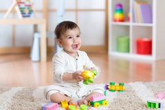 Happy baby playing in the constructor Royalty Free Stock Images
