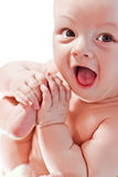 Happy baby playing with hands and legs Royalty Free Stock Photography