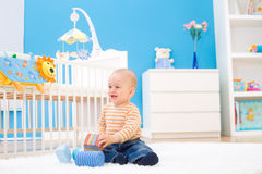 Happy baby playing indoor royalty free stock image