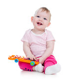 Happy baby playing musical toy royalty free stock photos