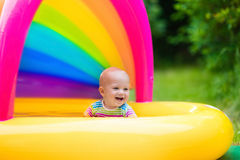 Happy baby playing in swimming pool Stock Photography