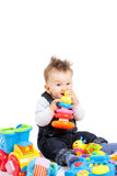 Happy baby playing with toys, isolated Stock Photo