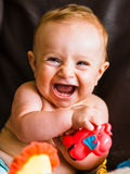 Happy baby. Playing with toys in the sofa Stock Photo