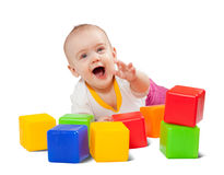 Happy baby plays  with toy blocks Royalty Free Stock Images