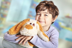 Happy baby with plush. Happy child with a dog of plush Stock Photos