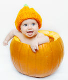 Happy baby in a pumpkin royalty free stock photography