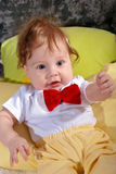 Happy baby in the red tie Stock Photos