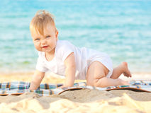 Happy baby relaxing at the beach. Stock Images