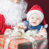Happy baby and Santa Claus with big gift, present box Royalty Free Stock Photos