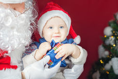 Happy baby and Santa Claus with big gift, present box Royalty Free Stock Images