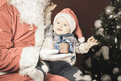Happy baby and Santa Claus with big gift, present box Stock Images