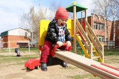 Happy baby on seesaw outdoors Royalty Free Stock Photos