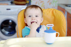 Happy baby  sitting on baby chair Royalty Free Stock Images