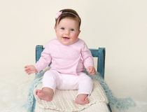 Happy Baby Sitting on Bed Royalty Free Stock Image