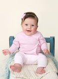 Happy Baby Sitting on Bed Royalty Free Stock Photos