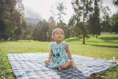 Happy baby sitting in the park Royalty Free Stock Image