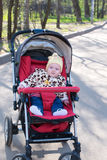Happy Baby sitting in stroller Stock Photo