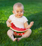 Happy baby with slice of watermelon Stock Photos