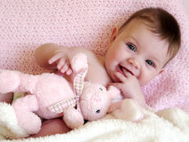Happy baby smiling with bunny royalty free stock image