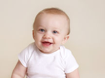 Happy Baby Smiling and Laughing. Looking at camera, milestones and development concept Royalty Free Stock Images