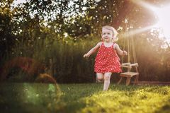 Happy baby smiling. little girl running stock photography