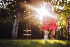 Happy baby smiling. little girl running royalty free stock images