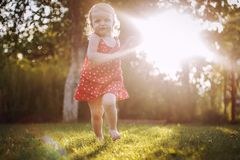 Happy baby smiling. little girl running royalty free stock photography