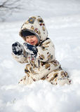 Happy baby in snow Stock Photos