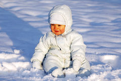 Happy baby in the snow Royalty Free Stock Image