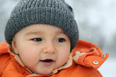 Happy baby with snow in winter Stock Photo