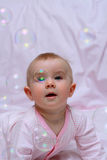 Happy baby and soap bubbles Royalty Free Stock Images