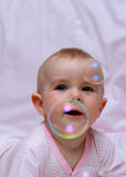 Happy baby and soap bubbles Royalty Free Stock Photo