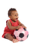 Happy baby with soccer ball royalty free stock images