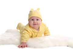 Happy baby on a soft rug Stock Photography