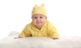 Happy baby on a soft rug Royalty Free Stock Photos
