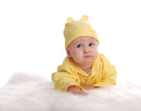 Happy baby on a soft rug Royalty Free Stock Images