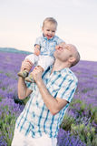 Happy baby son with dad Stock Image