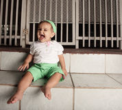 Happy baby on the steps Stock Images