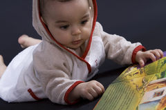 Happy baby on story time Royalty Free Stock Photos