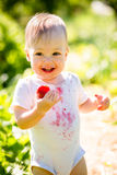 Happy baby with strawberry Royalty Free Stock Photos