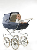 Happy baby in the stroller Stock Photos