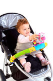 Happy baby in stroller Stock Photos