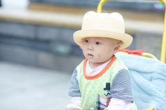 Happy baby in stroller Stock Images