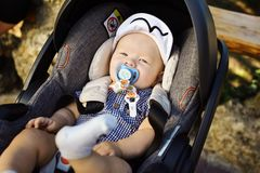 Happy baby in stroller royalty free stock images