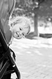 Happy baby in a stroller Royalty Free Stock Image
