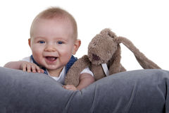 Happy baby with stuffed animal. Against white background Stock Photos