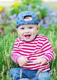 Happy baby in summer. Happy baby age of 10 months in summer Stock Photo