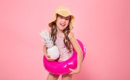 Happy child with pineapples on a colored background stock photos