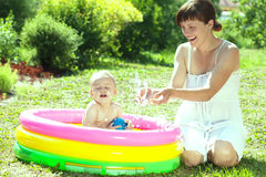 Happy baby swimming  in  inflatable pool Stock Photography